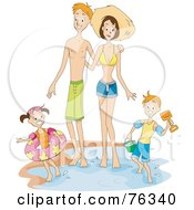 Happy Family Standing In The Water At The Beach