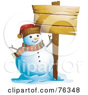 Happy Snowman Beside A Blank Wooden Sign