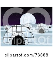 Village Of Igloo Dwellings Under A Full Moon