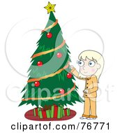 Blond Girl In Her Pajamas Decorating A Christmas Tree