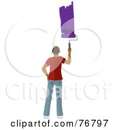 Hispanic Man Painting A Stripe Of Purple Paint On A Wall