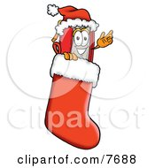 Red Book Mascot Cartoon Character Wearing A Santa Hat Inside A Red Christmas Stocking