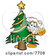 Chefs Hat Mascot Cartoon Character Waving And Standing By A Decorated Christmas Tree