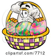 Chefs Hat Mascot Cartoon Character In An Easter Basket Full Of Decorated Easter Eggs