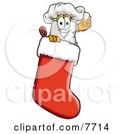 Clipart Picture Of A Chefs Hat Mascot Cartoon Character Inside A Red Christmas Stocking by Toons4Biz