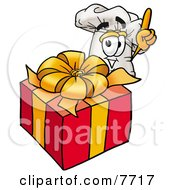 Clipart Picture Of A Chefs Hat Mascot Cartoon Character Standing By A Christmas Present