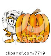 Clipart Picture Of A Chefs Hat Mascot Cartoon Character With A Carved Halloween Pumpkin