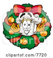 Clipart Picture Of A Chefs Hat Mascot Cartoon Character In The Center Of A Christmas Wreath