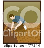 Caucasian Man Kneeling And Hammering While Installing Wood Floors
