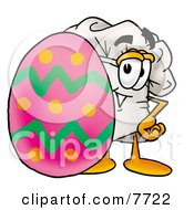 Clipart Picture Of A Chefs Hat Mascot Cartoon Character Standing Beside An Easter Egg
