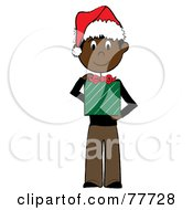 Black Stick Boy Wearing A Santa Hat And Holding A Christmas Gift