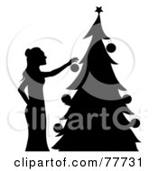 Royalty Free RF Clipart Illustration Of A Silhouette Of A Woman Hanging Ornaments On Her Christmas Tree by Pams Clipart