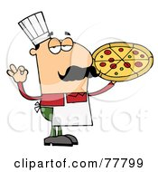 Pleased Male Caucasian Pizza Chef With His Perfect Pie
