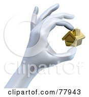 Royalty Free RF Clipart Illustration Of A 3d Hand Pinching A Tiny Golden House by Tonis Pan