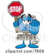 Desktop Computer Mascot Cartoon Character Holding A Stop Sign