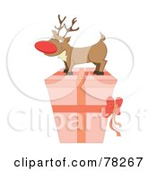 Royalty Free RF Clipart Illustration Of A Rudolph On Top Of A Pink Christmas Present by MilsiArt