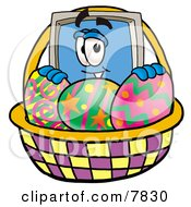 Clipart Picture Of A Desktop Computer Mascot Cartoon Character In An Easter Basket Full Of Decorated Easter Eggs by Toons4Biz