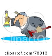 Plumber Man Standing In A Puddle Of Water Backup Holding A Wrench And Shining A Flashlight