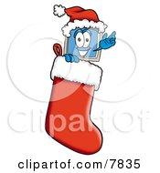 Desktop Computer Mascot Cartoon Character Wearing A Santa Hat Inside A Red Christmas Stocking