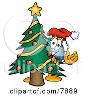 Clipart Picture Of A World Earth Globe Mascot Cartoon Character Waving And Standing By A Decorated Christmas Tree by Toons4Biz