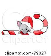 Royalty Free RF Clipart Illustration Of A Cute Christmas Mouse Looking Over A Candy Cane And Wearing A Santa Hat by Pams Clipart