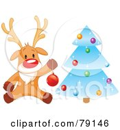 Royalty Free RF Clipart Illustration Of A Cute Rudolph The Red Nosed Reindeer Hanging Baubles On A Blue Icy Christmas Tree by Pushkin