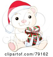 Royalty Free RF Clipart Illustration Of An Adorable Baby Polar Bear Wearing A Santa Hat And Holding A Christmas Gift by Pushkin