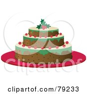 Tasty Three Layered Christmas Cake With Berries And A Holly Garnish