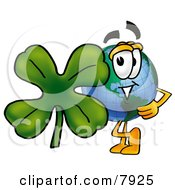 World Earth Globe Mascot Cartoon Character With A Green Four Leaf Clover On St Paddys Or St Patricks Day