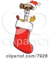 Mallet Mascot Cartoon Character Wearing A Santa Hat Inside A Red Christmas Stocking
