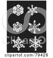 Digital Collage Of Six White Snowflakes On A Dark Background