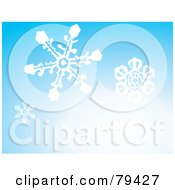 Gradient Blue Background With Three Falling White Winter Snowflakes
