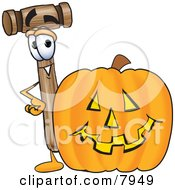 Clipart Picture Of A Mallet Mascot Cartoon Character With A Carved Halloween Pumpkin by Toons4Biz