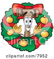 Clipart Picture Of A Mallet Mascot Cartoon Character In The Center Of A Christmas Wreath by Toons4Biz