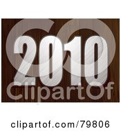 Royalty Free RF Clipart Illustration Of A 3d Brushed Metal 2010 On A Wooden Background by michaeltravers