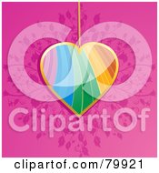 Rainbow And Gold Heart Pendant Over A Pink Floral Background