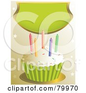 Vanilla Frosted Cupcake With Sprinkles And Colorful Candles Under A Green Banner
