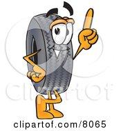 Rubber Tire Mascot Cartoon Character Pointing Upwards