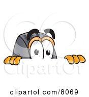 Rubber Tire Mascot Cartoon Character Peeking Over A Surface