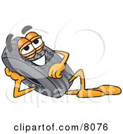 Clipart Picture Of A Rubber Tire Mascot Cartoon Character Resting His Head On His Hand by Toons4Biz