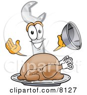 Clipart Picture Of A Wrench Mascot Cartoon Character Serving A Thanksgiving Turkey On A Platter by Toons4Biz