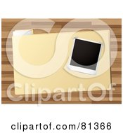 Royalty Free RF Clipart Illustration Of A Blank Polaroid Picture On A File Over A Wood Desk by michaeltravers
