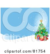 Royalty Free RF Clipart Illustration Of A Christmas Tree With Presents On A Snowy Hill Under A Blue Sky