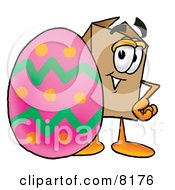 Clipart Picture Of A Cardboard Box Mascot Cartoon Character Standing Beside An Easter Egg