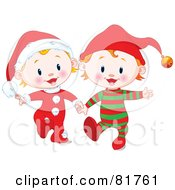 Two Christmas Babies In Santa And Elf Suits Walking And Holding Hands