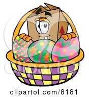 Clipart Picture Of A Cardboard Box Mascot Cartoon Character In An Easter Basket Full Of Decorated Easter Eggs