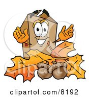 Clipart Picture Of A Cardboard Box Mascot Cartoon Character With Autumn Leaves And Acorns In The Fall