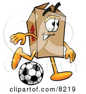 Clipart Picture Of A Cardboard Box Mascot Cartoon Character Kicking A Soccer Ball by Toons4Biz