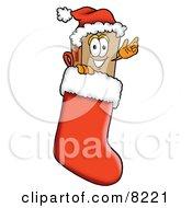 Cardboard Box Mascot Cartoon Character Wearing A Santa Hat Inside A Red Christmas Stocking