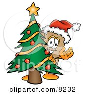 Clipart Picture Of A Cardboard Box Mascot Cartoon Character Waving And Standing By A Decorated Christmas Tree by Toons4Biz